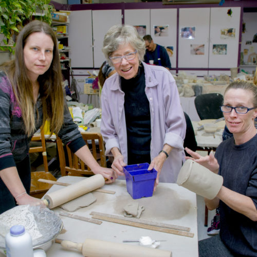 Sister Helen Kluke and two students doing pottery